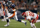 The Denver Broncos' Rod Smith (#80, WR)catches a pass in front of the Kansas City Chiefs' Dexter...