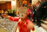 Chinese Ambassador Zhou Wenzhong, right, enjoys a performance from Anan Krutsinger, 5, and other...
