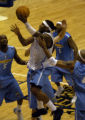 Carmelo Anthony goes up for a layup as Theron Smith (5) and Voshon  Lenard watch during a Denver...