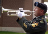 Ernie Mazurkiwicz (cq) plays taps during a Memorial service at Fort Carson's Soldiers Memorial...