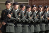 The 43rd ASG Honor Guard perpares to fire a salute during the Memorial service at Fort Carson's...