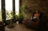 Renee in the sunroom which rests upon a 4 ft deep rockbed designed to retain heat radiating it out...