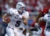Air Force quarterback Shaun Carney runs the ball against Utah during their game at Rice-Eccles...