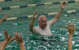 Ross Getchell (cq), 73 years old, takes part in a water aerobics class at the Fitzsimons Swimming...