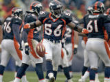 Denver Broncos line backer, Al Wilson, middle #56, celebrates after he recovered the football...
