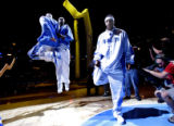 Denver Nuggets third year forward, Carmelo Anthony, right, stretches as teammates Kenyon Martin,...