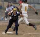 Thomas Jefferson's Amanda Weaver beats the throw to Kennedy's Jamie Cottrell at first in the...