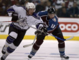 The LA Kings' Michael Cammalleri and Avalanche's Alex Tanguay race for the puck in the 2nd period...
