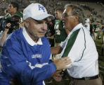 JPM308 Air Force Academy Falcons coach Fisher DeBerry, left, and  Colorado State Rams coach Sonny...