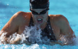Water coats Amanda Beard as she swims to a first place finish in the 100 meter breaststroke at the...