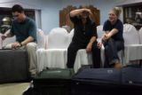 (1/16/05,Chennai, India)   Greg Gustafson, Teri Lynn, and Courtney Shepherd take a load off their...