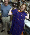 (1/16/05,Chennai, India)   Dawn Anderson asks Nanci Ricks if the Bronco colored outfit suited her....