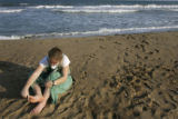 (1/17/05,Kaalapet, India)   Kaylin Shaw, 18, the youngest of the group, brushes sand off her feet...