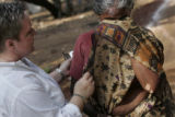 (1/17/05,Kaalapet, India)   Deb Lake comforts Rani Chrustraj, who said she lost everything in the...