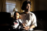 (DENVER ,CO., January 17, 2005) Margaret Reed holds her great gran daughter Cheyenne in her Denver...