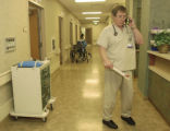 Lone Tree, CO 01/16/05 Emergency room physician Dr. Guy Clifton uses a Spectralink phone to...
