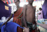 (1/18/05, Singarathoppu , India)   Teri Lynn gives a young boy a check up and determined that he...