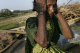 (1/18/05, Singarathoppu , India)   Pappamal lost her granddaughter Sudha, 20, in the tsunami.  She...
