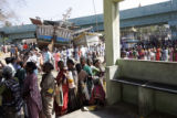 (1/18/05, Singarathoppu , India)   Women wait in line for cooking utensils from World Vision.  The...