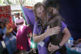 (1/18/05, Singarathoppu , India)   Teri Lynn comforts a scared patient in her pediatric section of...