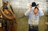 (Denver, Colo., 1/19/05- David Motes takes care of his horse after competing in the team roping...