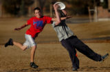 (GREENWOOD VILLAGE, CO., JANUARY 20, 2005)    Spencer Branson, 15, (cq) right, a sophmore, catches...