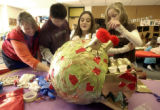 (Denver, Colo.- Feb. 4,2004) From left: Art teacher Angela Hottinger helps students Christian...