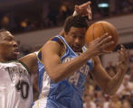 Minneapolis, Minn., Photo taken April 30, 2004- Nuggets guard Andre Miller gets swarmed by...