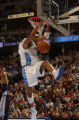 Denver, Colo., photo taken January 21, 2004- Nuggets forward, Kenyon Martin, dunks the ball to...
