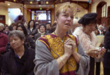 (DENVER, Colo., February 6, 2005)  Bernice Geels, center, of Denver, cries at a ceremony to...