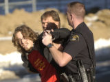 [(Aurora, CO, Shot on: 2/3/05)]  University of Colorado student Dustin Craun is arrested for...