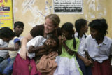 (1/21/05, Samiyarpettai, India)   Kaylin Shaw plays with village children in Samiyarpettai - an...