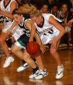 Littleton, Colo., photo taken Feb.3, 2005- ThunderRidge's Megan McCahill (left) and Arapahoe's...