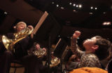 (Denver, Colo., February 7, 2005) Will Butterfield, 4, right, of Denver, conducts the symphony...