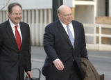 [(Denver, CO, Shot on: 2/8/05)] Mid-level Qwest manager Thomas W. Hall(right) leaves the federal...