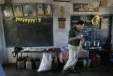 (1/25/05, Pondicherry, India)  Greg Gustafsen takes a look around the sterilization area before...