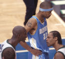 Minneapolis, Minn., Photo taken April 30, 2004- Nuggets center Marcus Camby nearing the end of the...