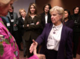 (DENVER, Colo., February 09, 2005)  Workshop teacher, Myrna Ann Adkins (rt) shakes hands with Ann...