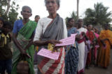 (1/26/05, Pondicherry, India)  Arjunnan, 65, waits in line for the distribution.  After a day full...