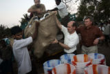 (1/26/05, Pondicherry, India)  P. Christopher, Dan Kane, David Hoffman, an OM worker and Rick...