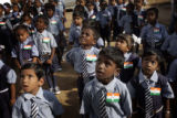 (1/26/05, Pondicherry, India)  Children attending one of the Dalit Education Centers watch the...