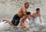 (Denver, Colo., July 14, 2004) Miguel Centeno, left, plays with his children, Jasmine Centeno, 11,...