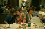 (1/27/05, Chennai, India)  Nanci Ricks gives Helen Parton a big hug tonight at the Last Supper the...