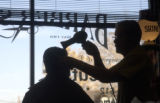 AURORA, COLO.-January 27,2005- Walt Young ,77, cuts the hair of customer Clifford Dutz on...