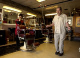 AURORA, COLO.-January 27,2005- Walt Young ,77,has been cutting hair in Denver for 55 years. He...