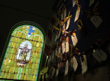 Antonito, Colo.shot on 2/6/05--Next to a stain glass image of San Jose, red, white, blue and...