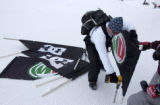 (Aspen, CO., January 26, 2005) Jeremy Dixon (center) puts up a signs on the Snowboard Slopestyle...