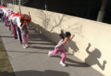 (Denver, CO., Feb. 11, 2005)  Yiran Zang, 7, runs ahead of her second grade class-mates as...