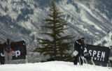 (Aspen, CO., January 26, 2005) Tracey Woolfolk, right, puts up signs on the Snowboard Slopestyle...