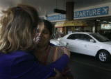 (1/28/05, Chennai, India)  Radha George, Samson George's wife, looks Nanci Ricks in the eyes...